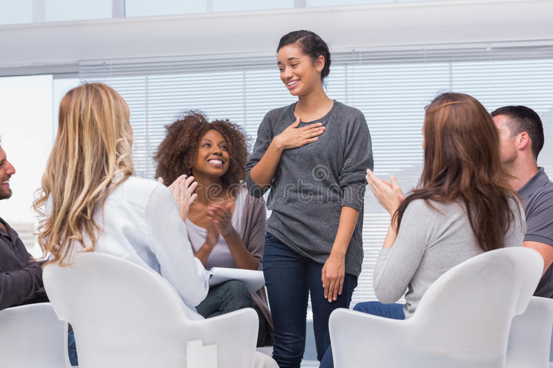 Happy patient has a breakthrough in group therapy royalty free stock photo