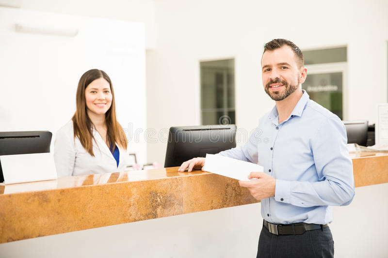 Happy patient with his test results royalty free stock images