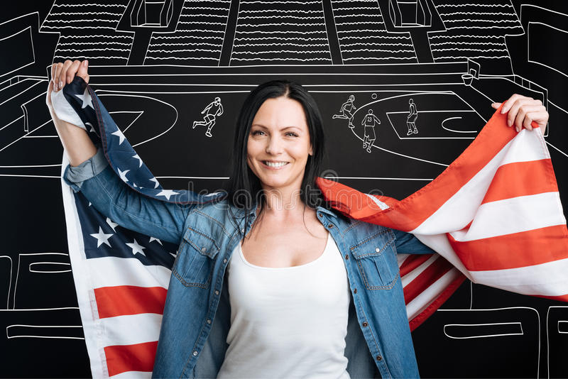 Happy patriotic woman supporting her team stock image