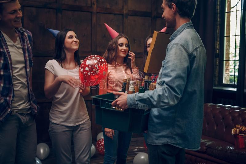 Happy people celebrate birthday with bottles of alcohol royalty free stock photos