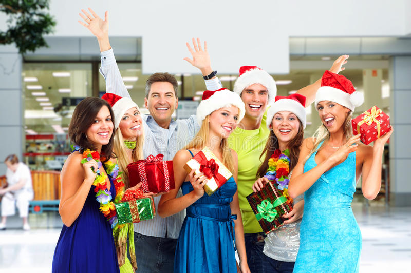 Happy people with Christmas gifts. stock photo