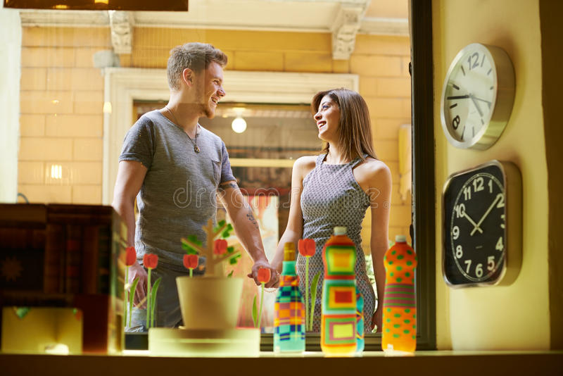 Happy people with couple at window store and shopping stock images