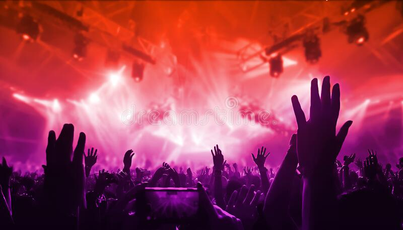 Happy People Dance in Nightclub Party Concert. Happy people dance in nightclub DJ party concert and listen to electronic dancing music from DJ on the stage royalty free stock photography