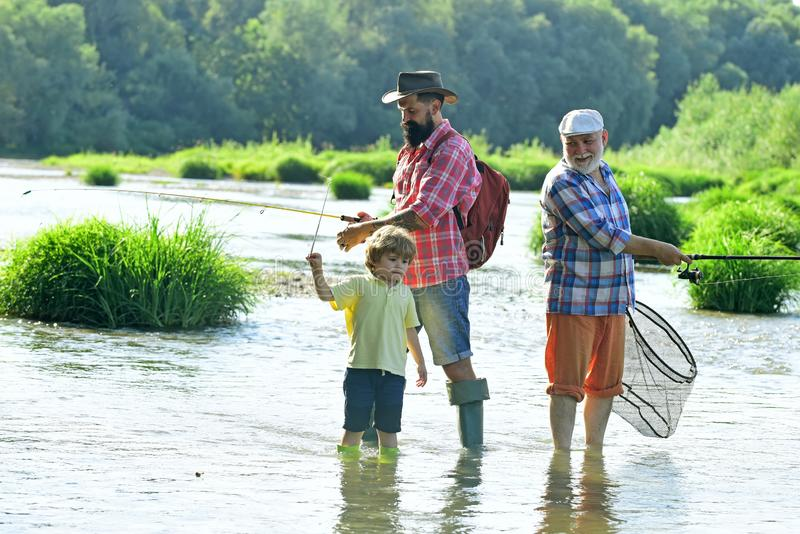Happy people family have fishing and fun together. Family fishermen fishing with spinning reel. Outdoors active stock photo