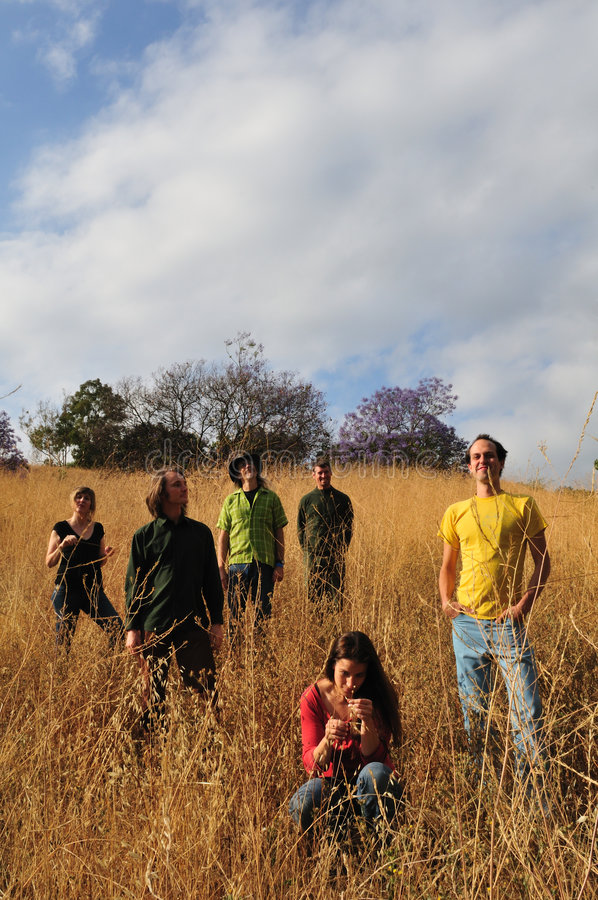 Happy people in field stock photography