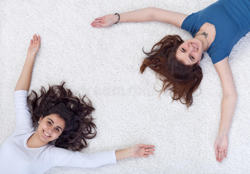 Download Happy People Frame - Teenagers Laying On The Floor Stock Image - Image: 22989985