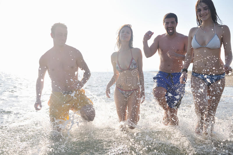 Happy People Group Have Fun And Running On Beach Stock Image