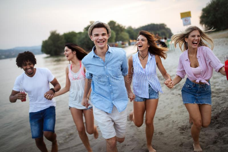 Happy people having fun in summer holidays. Friends, vacation, summer lifestyle and youth concept stock photography