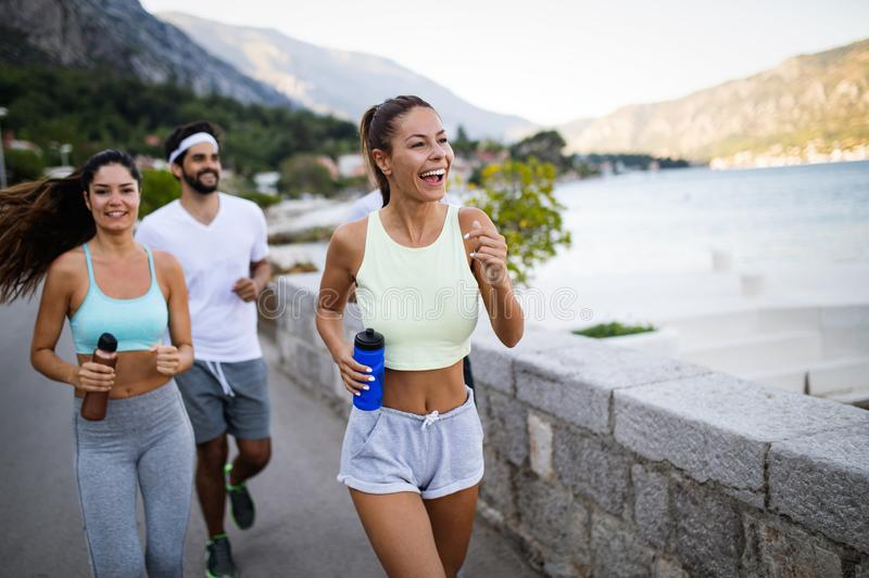 Happy people jogging outdoor. Running, sport, exercising and healthy lifestyle concept stock photo