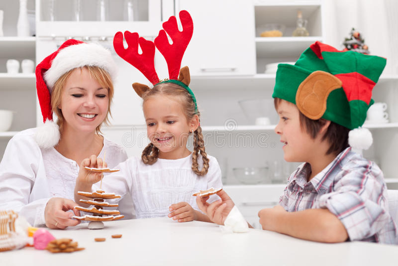 Happy people making gingerbread christmas tree royalty free stock photo
