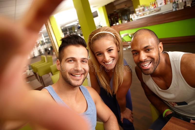 Happy people making selfie in gym stock photos