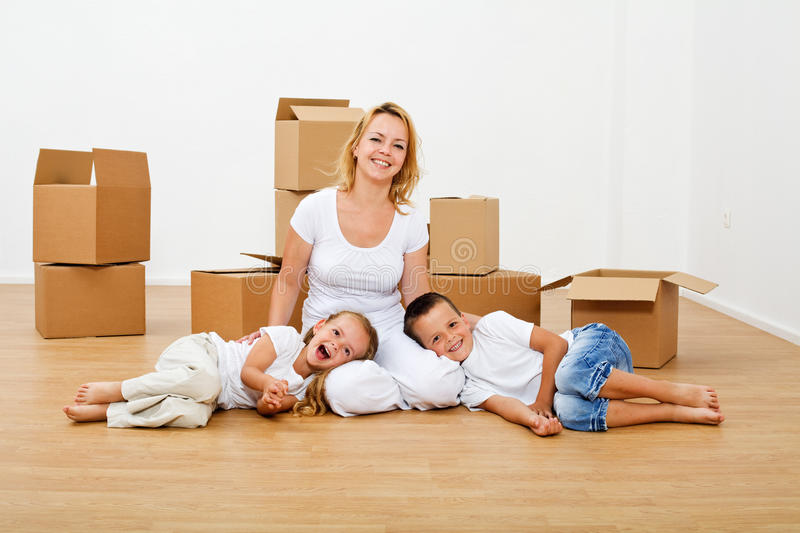 Happy people moving into a new house stock photo