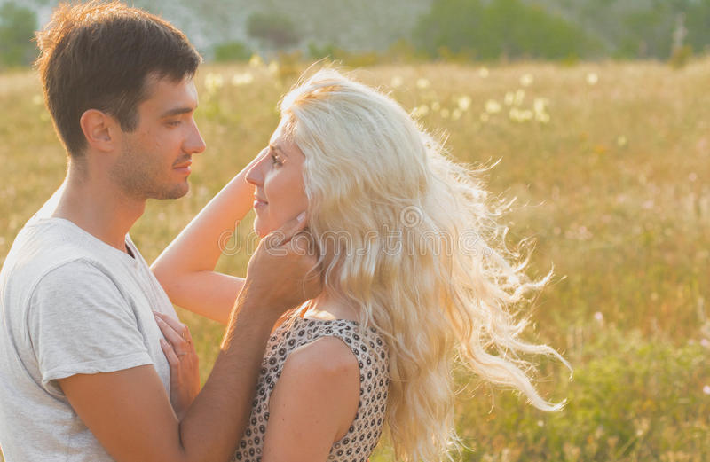 Happy people outdoors beautiful landscape and couple in love wit. Happy people outdoors beautiful landscape and couple in love near the road vintage stile royalty free stock images