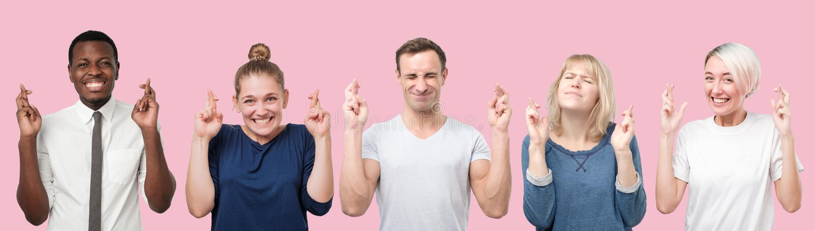 Happy people rejoice that dreams came true. Collage of men and women crossing fingers, closes anticipate hearing good news, isolated pink background stock photos