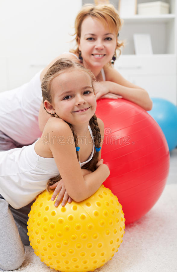 Happy people relaxing during gym exercises stock photography