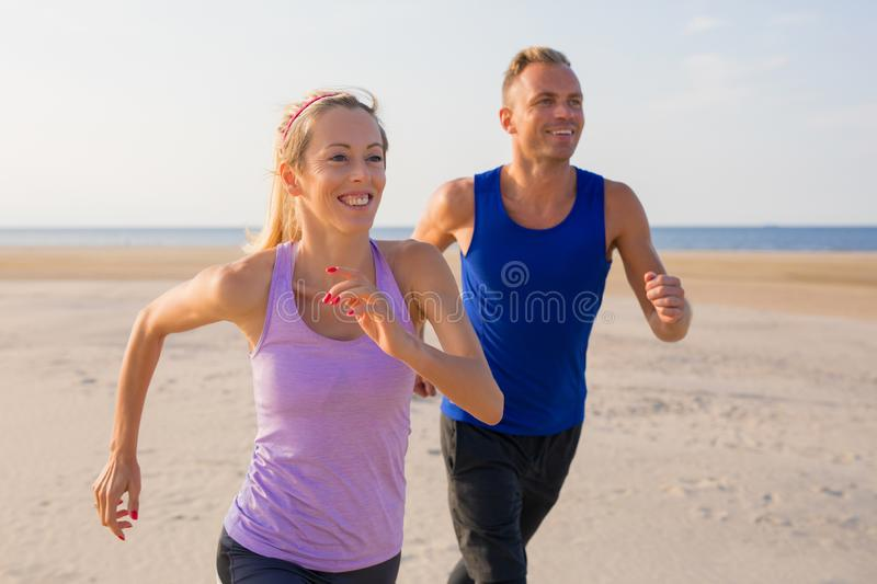 Happy people running outdoors together royalty free stock image