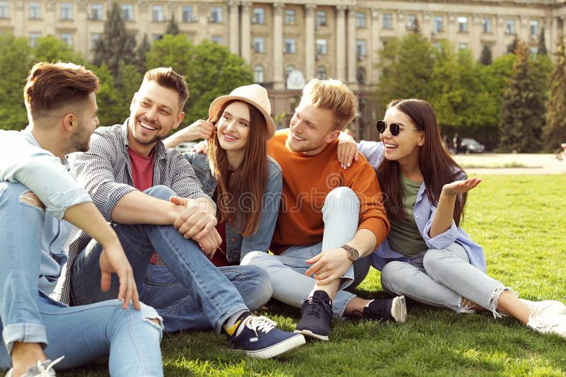 Happy people spending time together on green grass royalty free stock image
