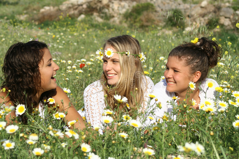 Happy people in summer. Group of happy people, girls youth teens or teenages smiling in summer stock photos
