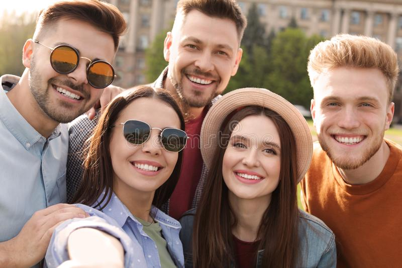 Happy people taking selfie outdoors stock images