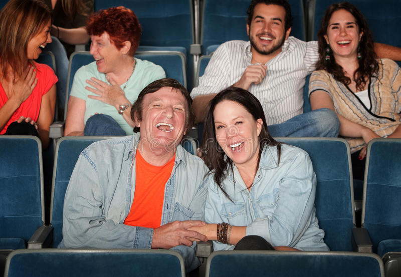 Happy People In Theater stock images