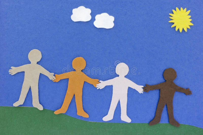 Happy people together. Fabric cutouts of people standing together and holding hands. Concept of diversity and being together. This is a home made toy (for our stock photos