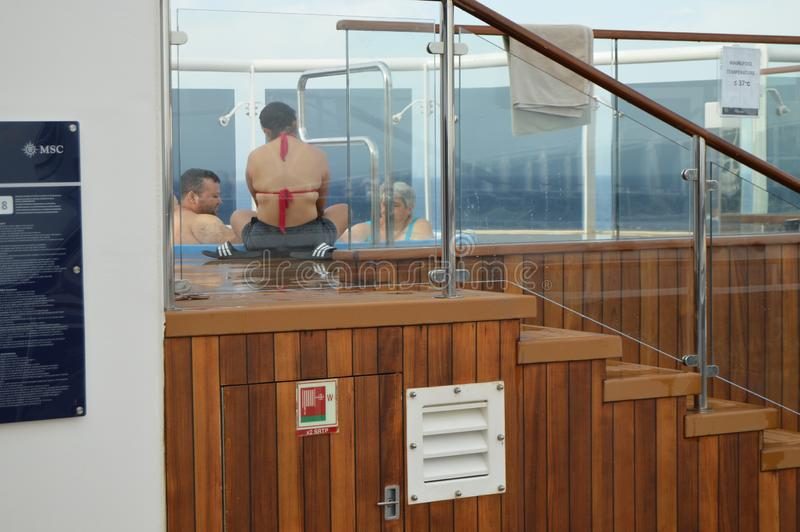 Happy people on vacation sit in the Jacuzzi pool on the cruise liner MSC Meraviglia, 10 October 2018 royalty free stock photo