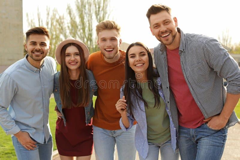 Happy people walking outdoors stock image