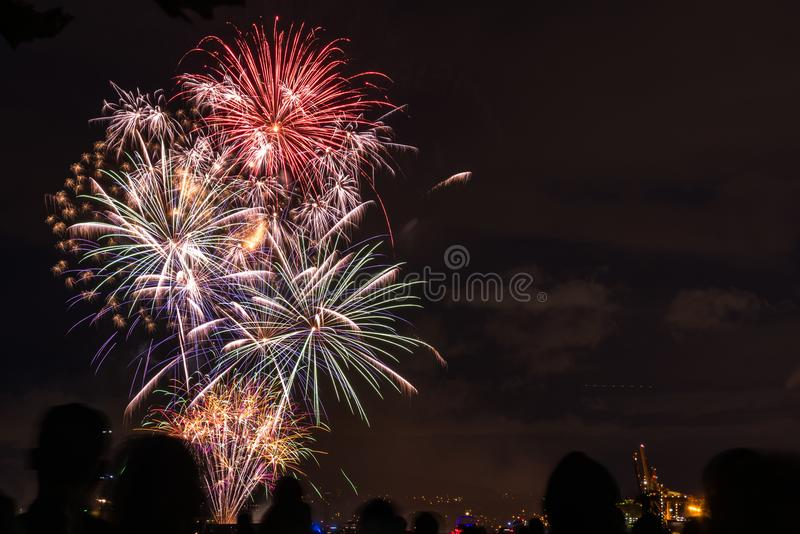 Colourful Fireworks with Silhouette of People Watching the Display. Happy People Watching Colourful Fireworks in Vancouver on Canada Day. Vancouver, BC, Canada royalty free stock image
