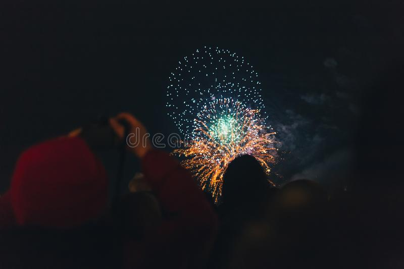Happy people watching fireworks stock image