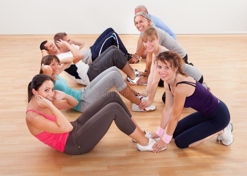 Happy people working out in a gym royalty free stock images