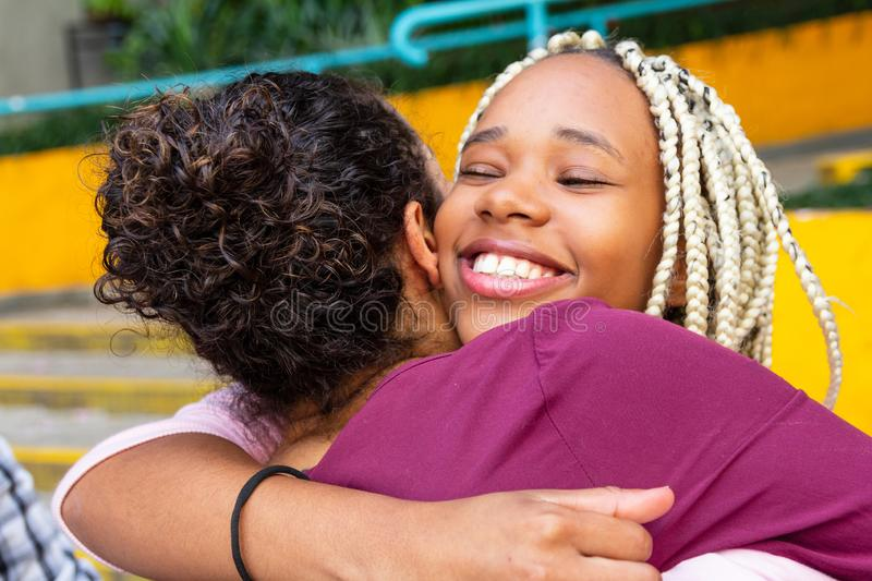 Person gives his friend a tight hug. Celebrations, reunions, meetings, friendship. Affection and union royalty free stock photo