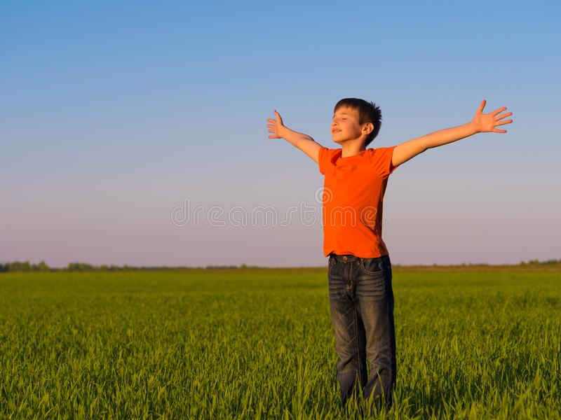 Happy person in the nature with raised arms stock photo