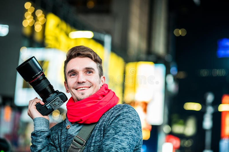 Happy Photographer Visiting Time Square in New York and Looking stock photos