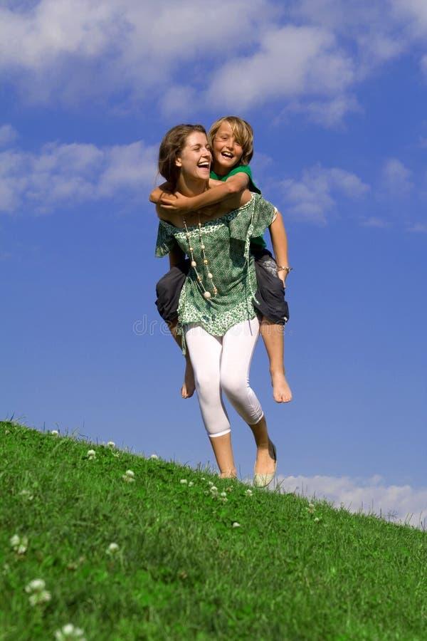 Happy piggyback family fun stock image