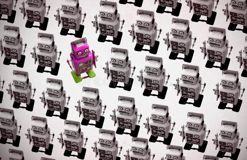 Happy pink robot goes against the crowd. Unique concept royalty free stock photos