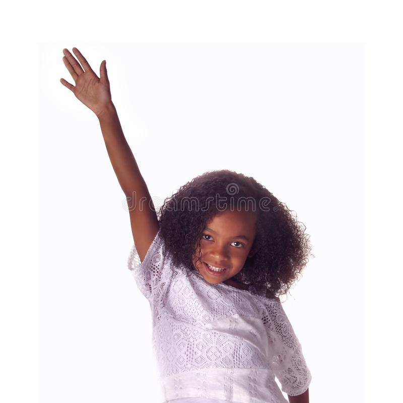 Happy playful child holding arms aloft royalty free stock photos