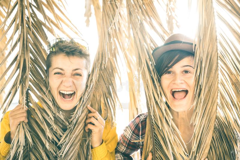 Happy playful girlfriends in love sharing time together at travel royalty free stock image