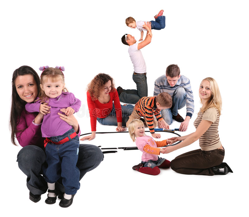 Happy playing families. On white royalty free stock image