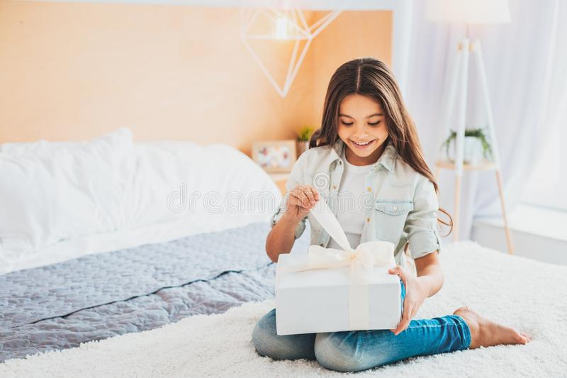 Happy pleased daughter feeling happy after parental surprise. Pleased daughter. Happy pleased daughter feeling extremely happy while receiving surprise from royalty free stock photography