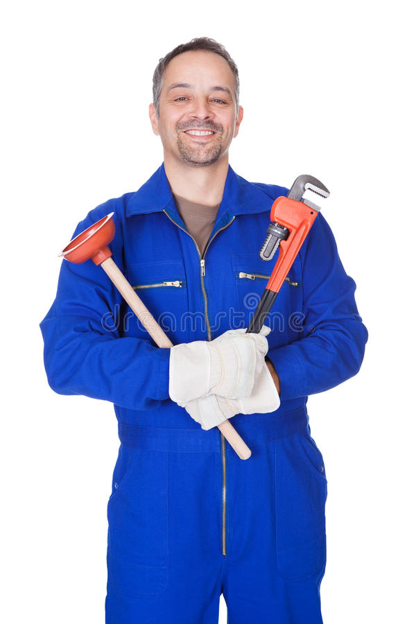 Happy Plumber Holding Plunger And Wrench. On White Background royalty free stock photos