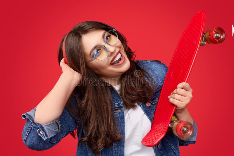 Happy plus size hipster listening to music stock images