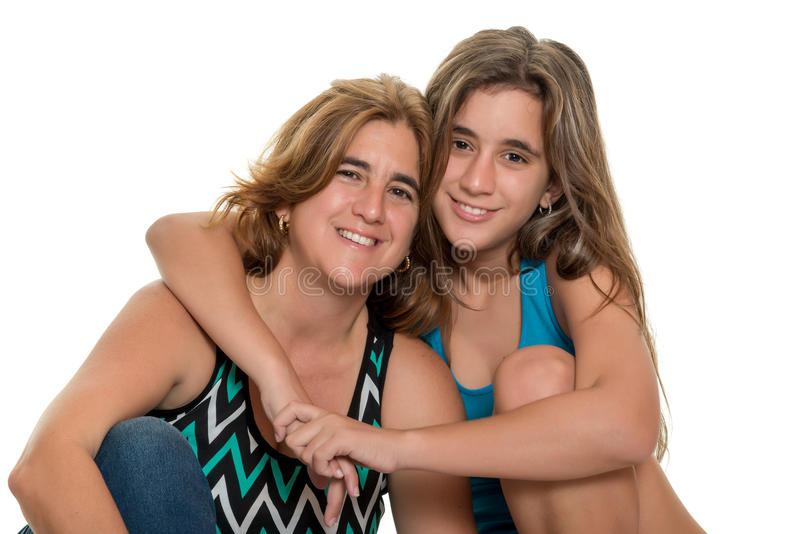 Happy portrait of a happy mother and her teen daughter. Portrait of a happy mother and her teenage daughter - Isolated on white royalty free stock photos