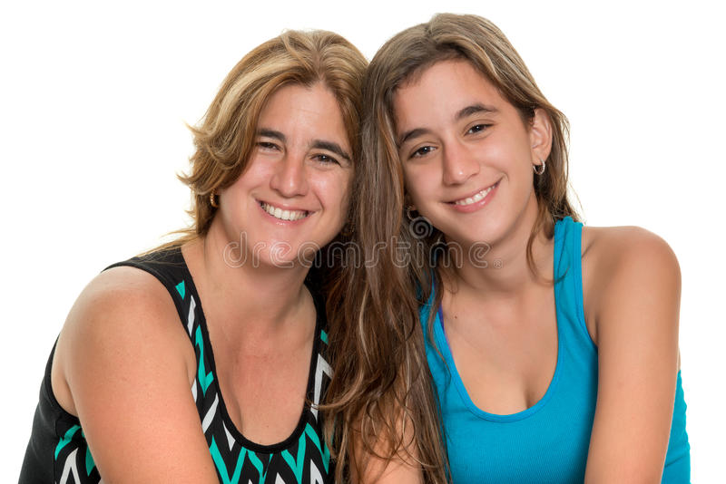Happy portrait of a happy mother and her teen daughter. Portrait of a happy mother and her teenage daughter - Isolated on white stock photo