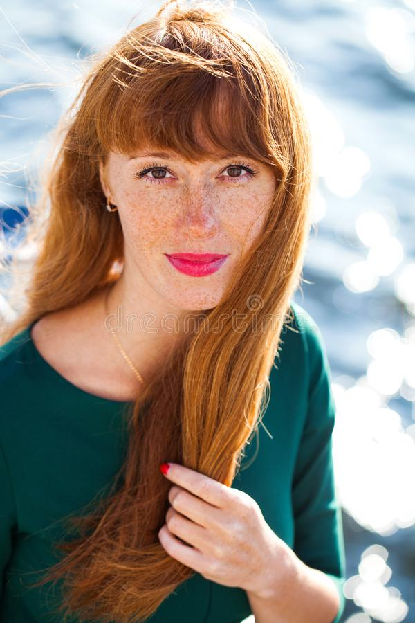 Happy Portrait red-haired woman. Close up portrait red-haired woman royalty free stock image