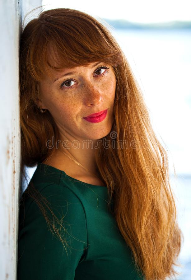 Happy Portrait red-haired woman. Close up portrait red-haired woman stock photo