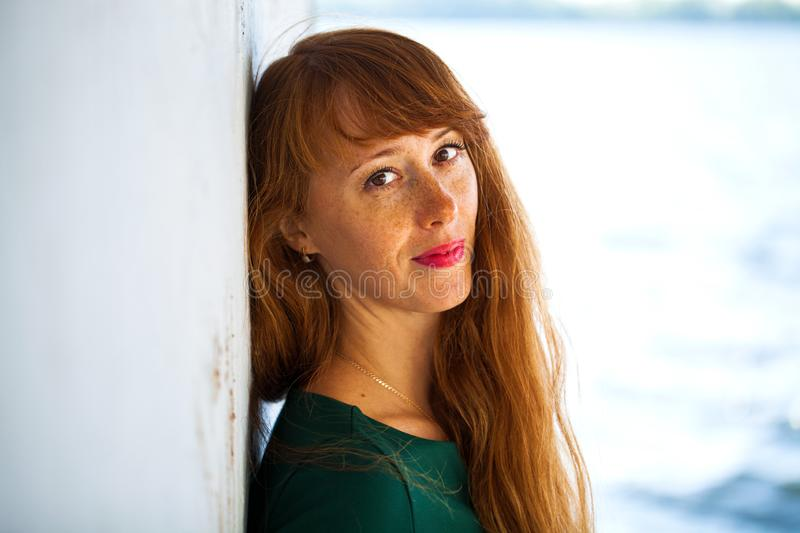 Happy Portrait red-haired woman. Close up portrait red-haired woman royalty free stock photos