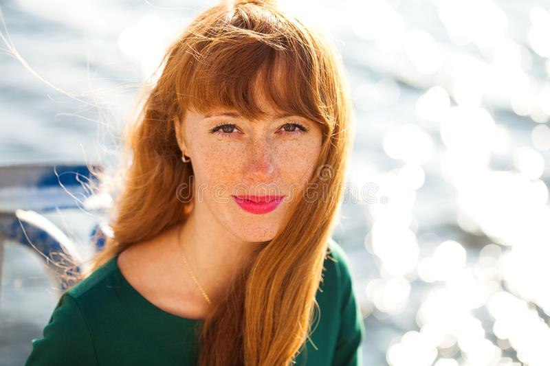 Happy Portrait red-haired woman. Close up portrait red-haired woman royalty free stock images