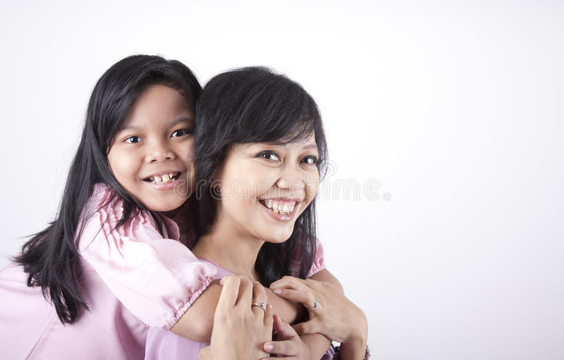 Download Happy Pose Of Mother And Daughter Stock Photo - Image: 21713658