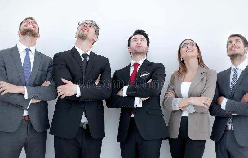 Happy positive business group looking up with dreaming expression royalty free stock photos
