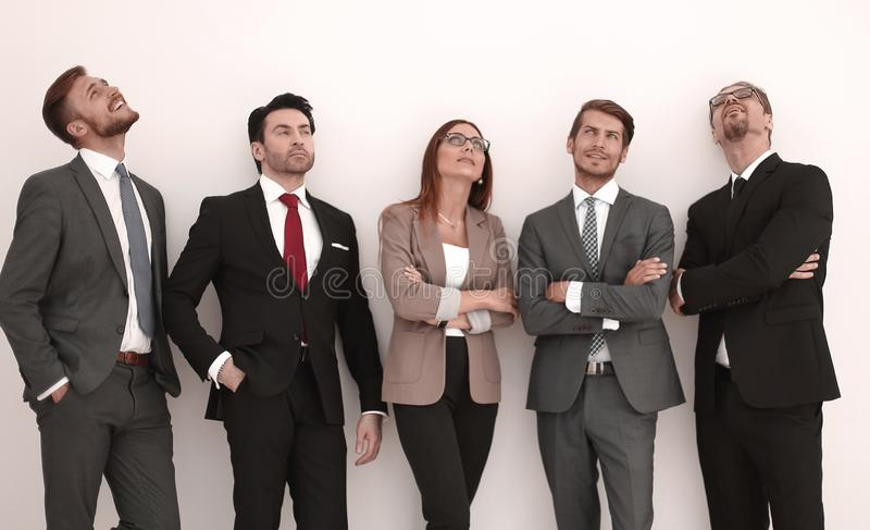 Happy positive business group looking up with dreaming expression royalty free stock photography